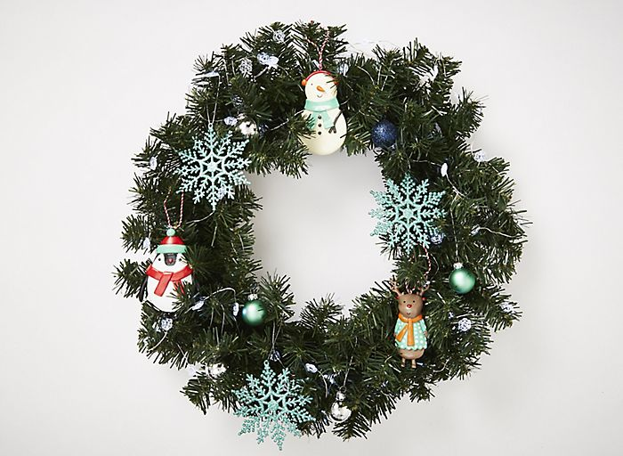 Christmas wreath personalised with Merry & Bright decorations