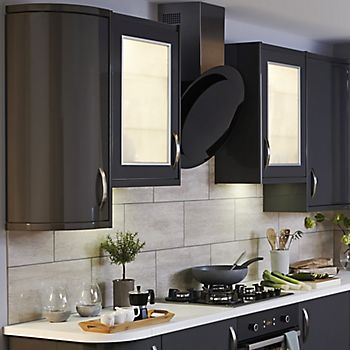 Lit-up kitchen wall cabinets in the IT Santini Gloss Anthracite Slab kitchen