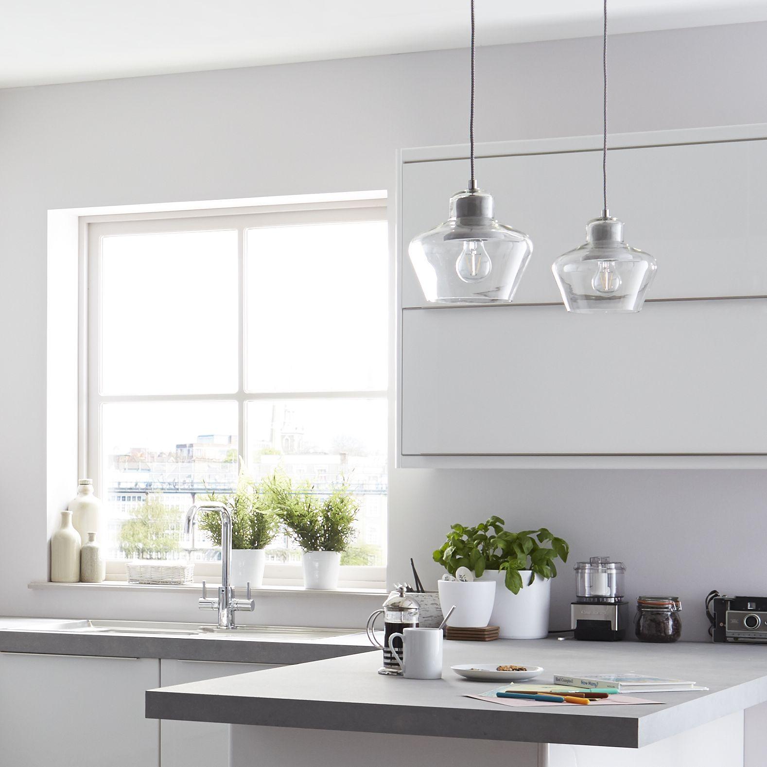 Glass pendant lights in the it santini white gloss slab kitchen