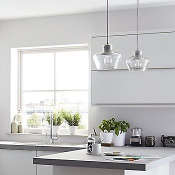 Glass pendant lights in the IT Santini White Gloss Slab kitchen