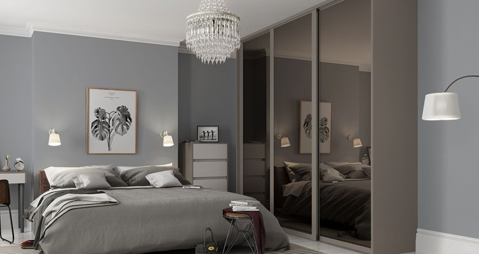 Sliding door wardrobe in a grey bedroom