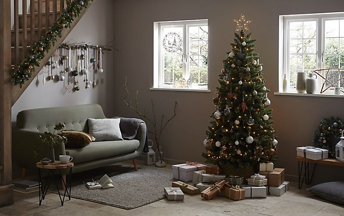 """Artificial Christmas tree decorated with Nordic Nature decorations"""
