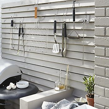 Cooking tools hanging on wall hooks