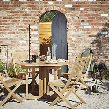 Roscana wooden garden furniture in the cottage garden