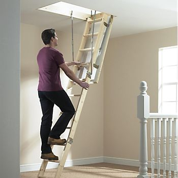 Man climbing loft ladder