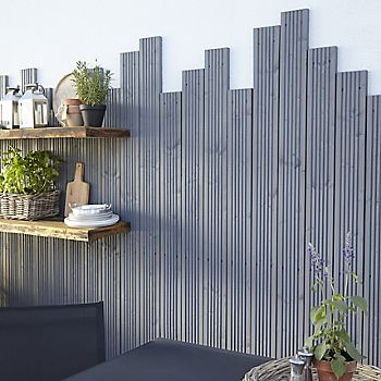 Grey decking fixed to a wall