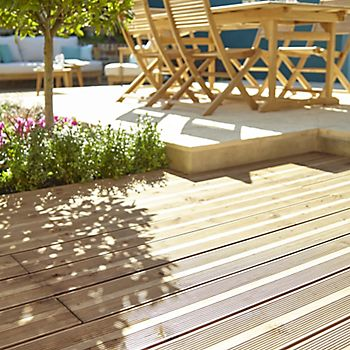 Natural deck boards oiled and a dining set stained in a garden