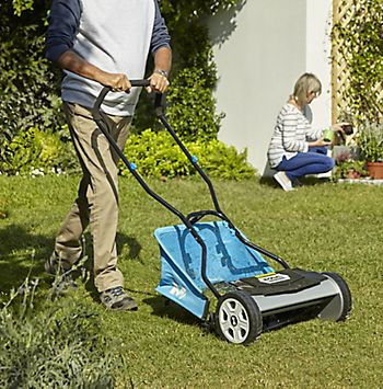 Man mowing the lawn with the McAllister lawnmower