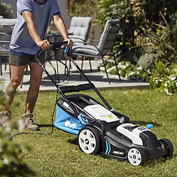 Man mowing lawn with Mac Allister lawnmower
