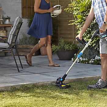 Trimming lawn'd edges with Mac Allister grass trimmer