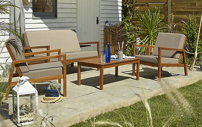 Paved patio area with Sakar wooden garden furniture
