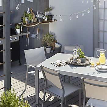 Verena metal garden furniture and string lighting in garden