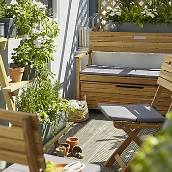Denia garden furniture range surrounded by plants in pots