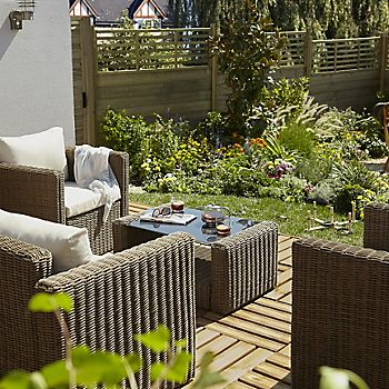 Decking with deck tiles and garden furniture