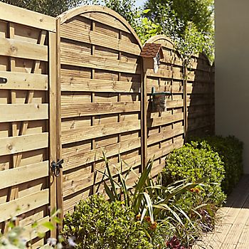 Oussouri domed fence panel in garden