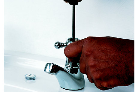 Man fixing dripping tap