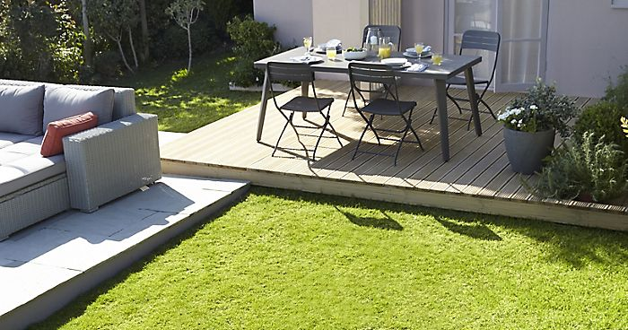 """garden with decked area and lawn"""