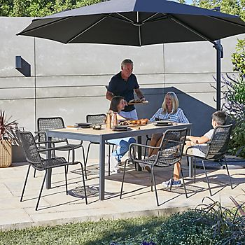 Family eating on Oberon metal dining furniture set