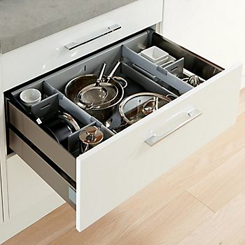 Cooke & Lewis Raffello high gloss white kitchen with drawer dividers