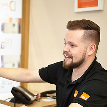 B&Q colleague helping customer