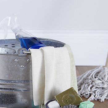 mop, bucket and other cleaning products to clean a vinyl floor
