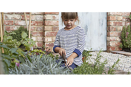 Child in walled garden