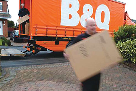 Man delivering parcel from B&Q lorry