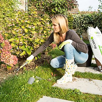 lady gardening with gloves on