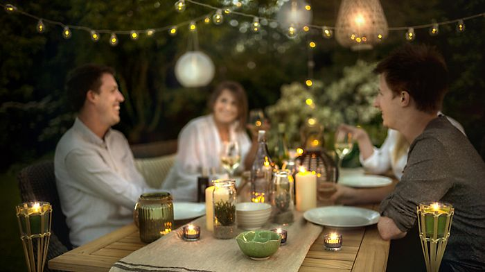 """Evening garden party with string lights"""