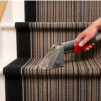 Rug Doctor carpet cleaner being used on stairs