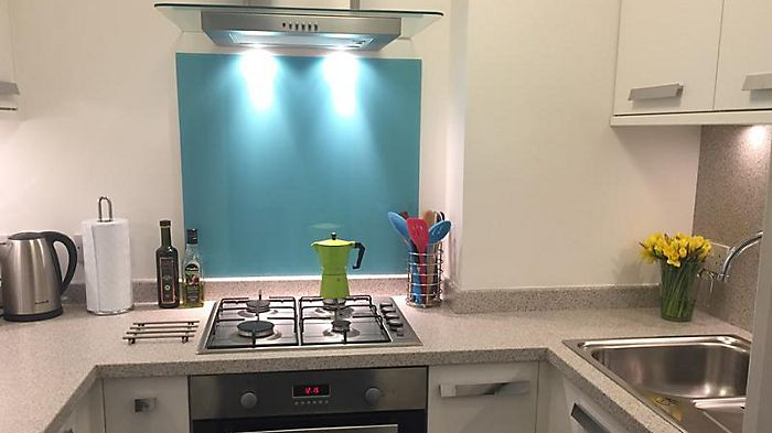 Kitchen featuring Atoll Blue Glass Splashback