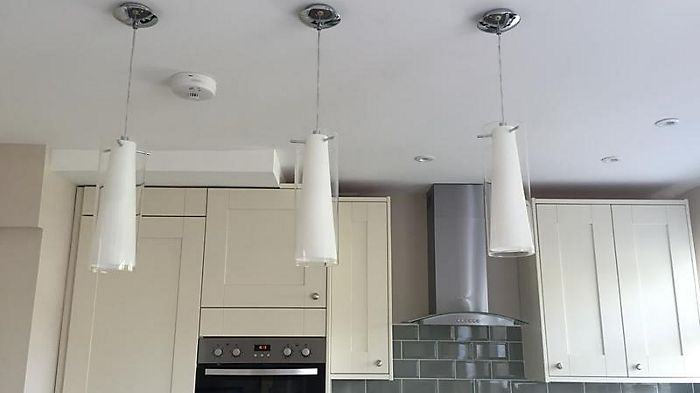 Kitchen featuring three Kamara Tube White Pendant Ceiling Lights