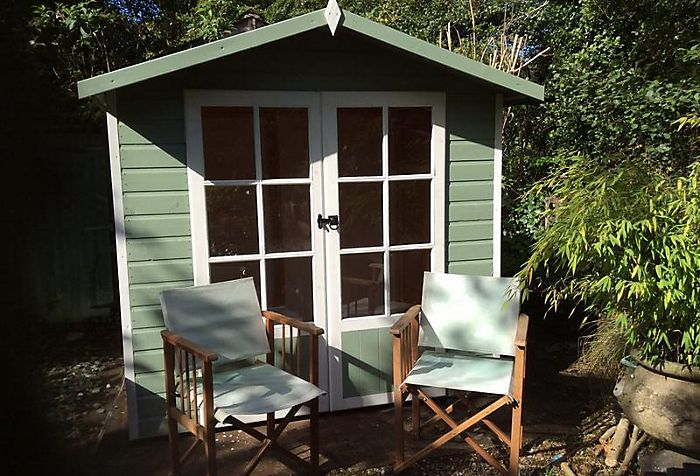 garden with summerhouse painted willow green and white