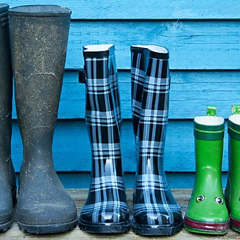 Different sizes of wellington boots lined up